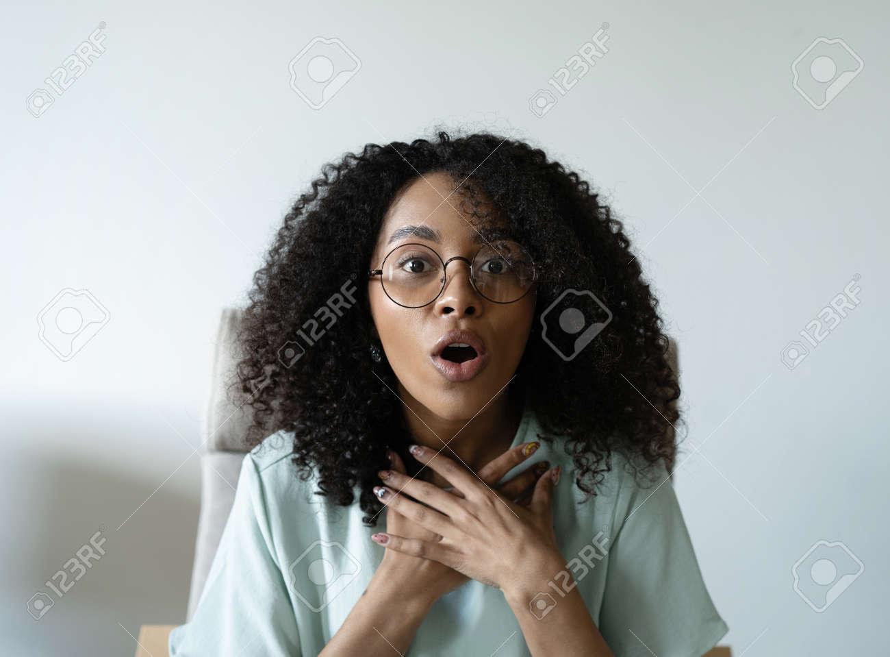 Head shot portrait friendly talking mixed race woman, looking at camera, making video call, recording vlog or webinar - 170765776