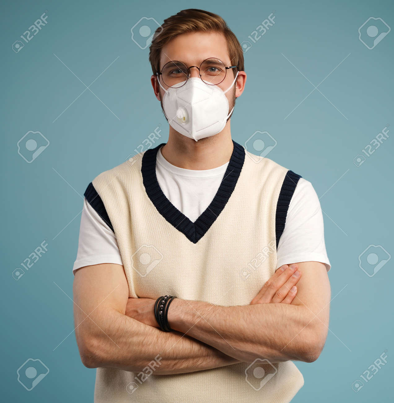 Portrait of handsome young man with surgical medical mask in casual style shirt standing, looking at camera with smile - 171597156