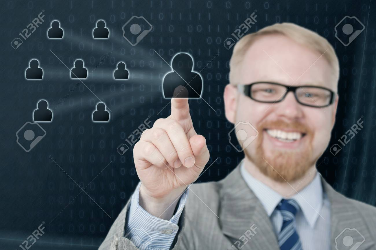 Smiling Man Selecting Virtual Icon, Focus at Fingertip Stock Photo - 21024315