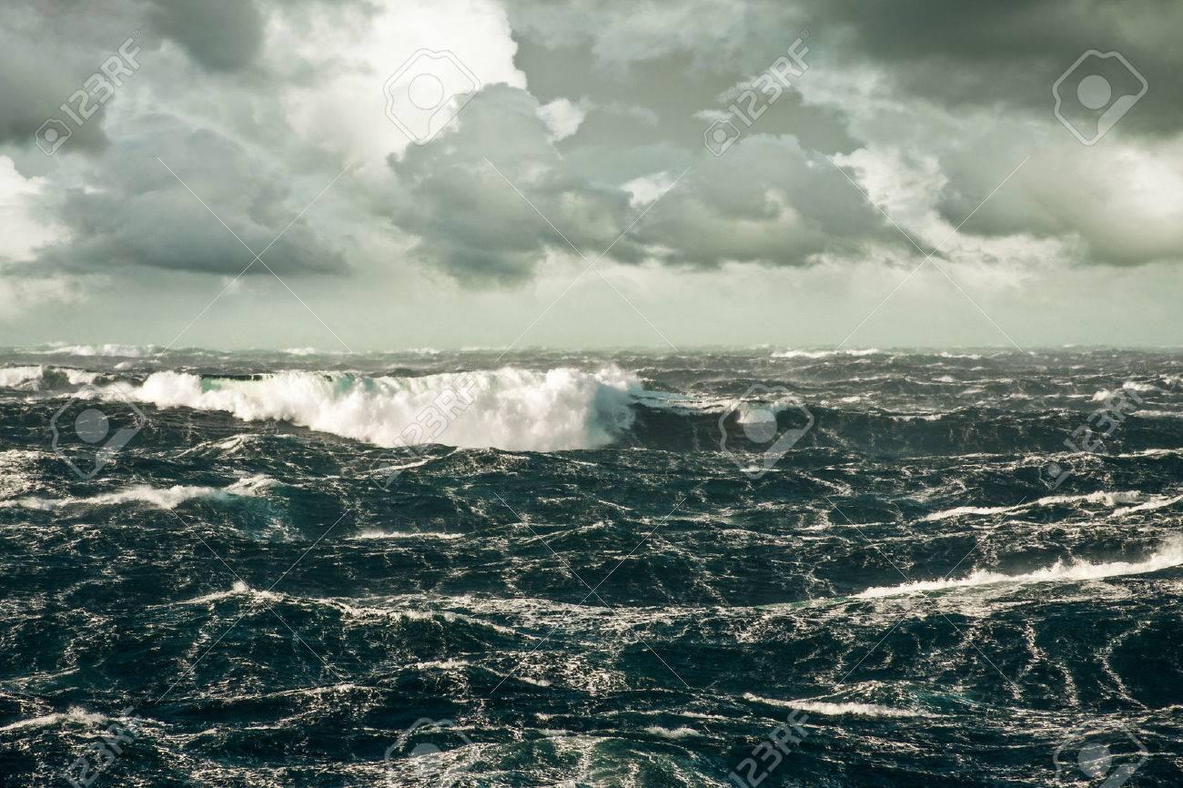Huge Wave Crashing Down at Storming North Atlantic - 23097381