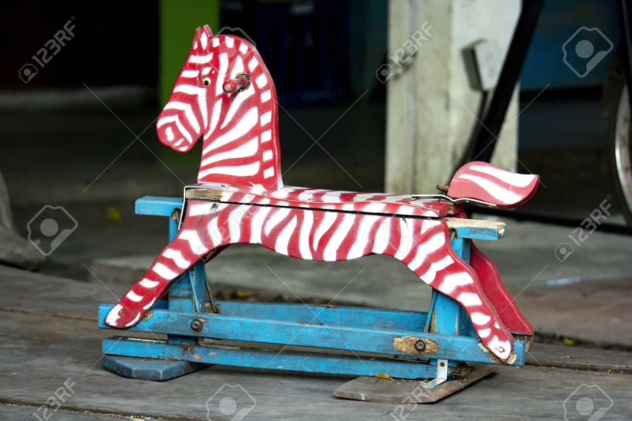 Wooden Rocking Horse With Color Paint On A Wooden Floor In The Stock Photo Picture And Royalty Free Image Image 112065432