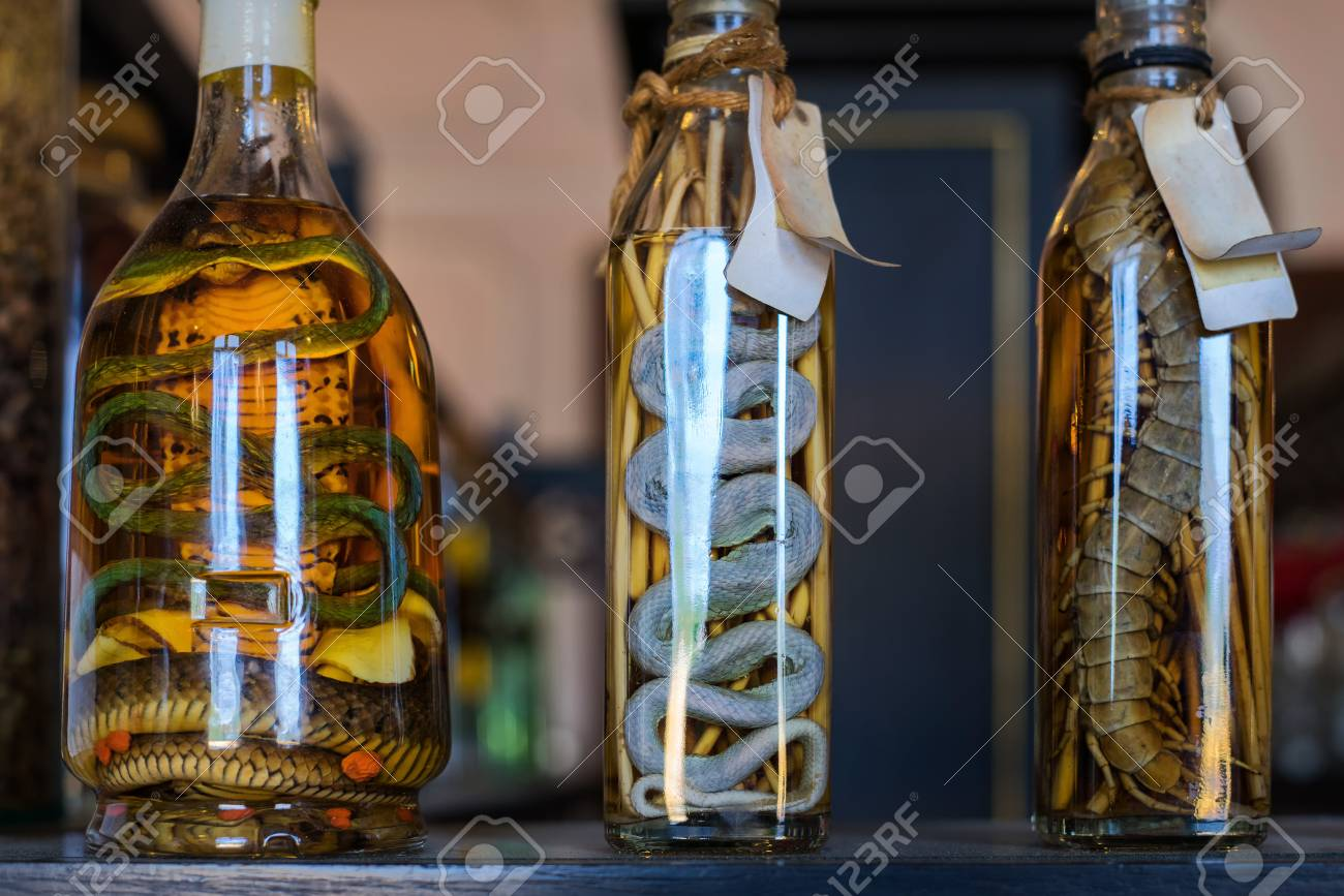 Thai traditional liquor with pickled snakes, cobra, giant centipede