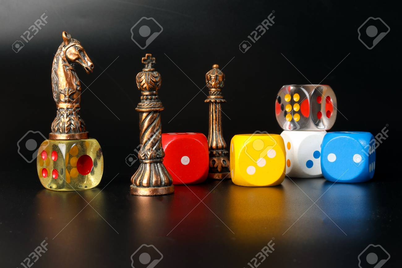 Colourful playing gaming dice transparent metal chess pieces on black background - 95212297