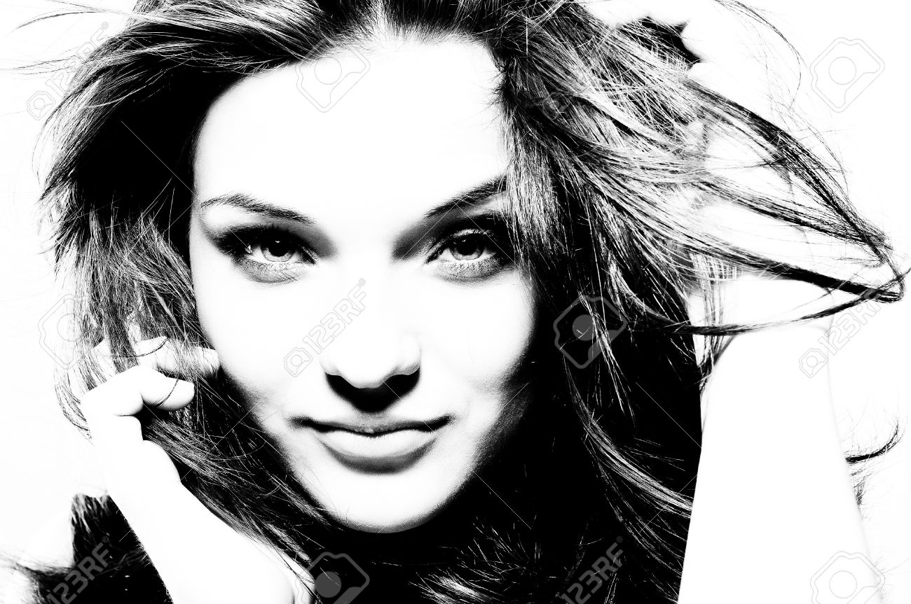 High contrast black and white portrait of beautiful girl with