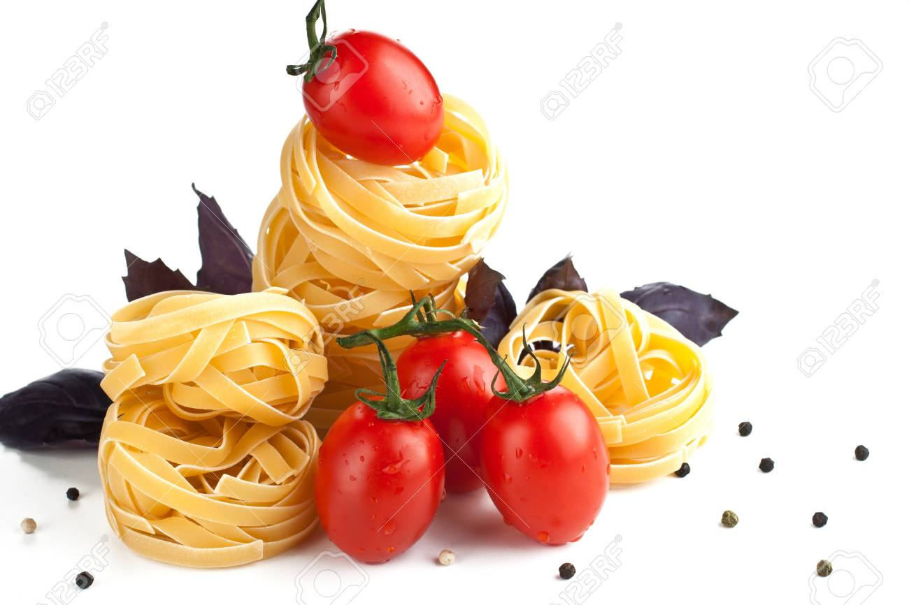 Raw pasta with tomatoes and basil Stock Photo - 15544099