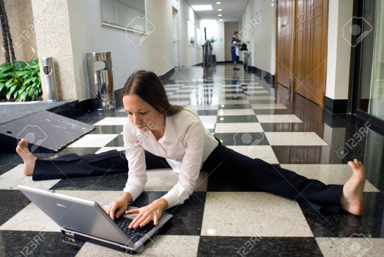 Woman on the floor working on her laptop Stock Photo - 2687464