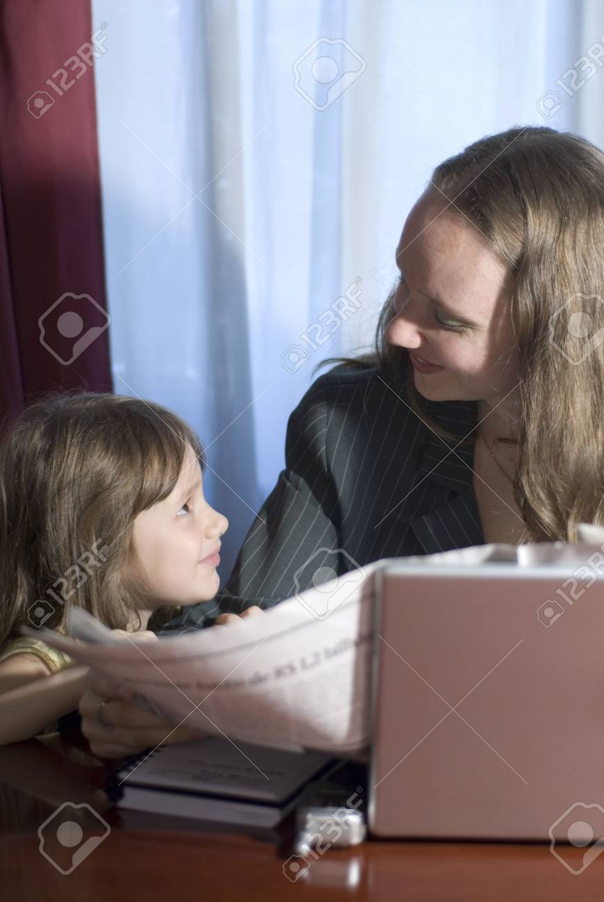 Business woman and her daughter bonding in a home office Stock Photo - 2719898