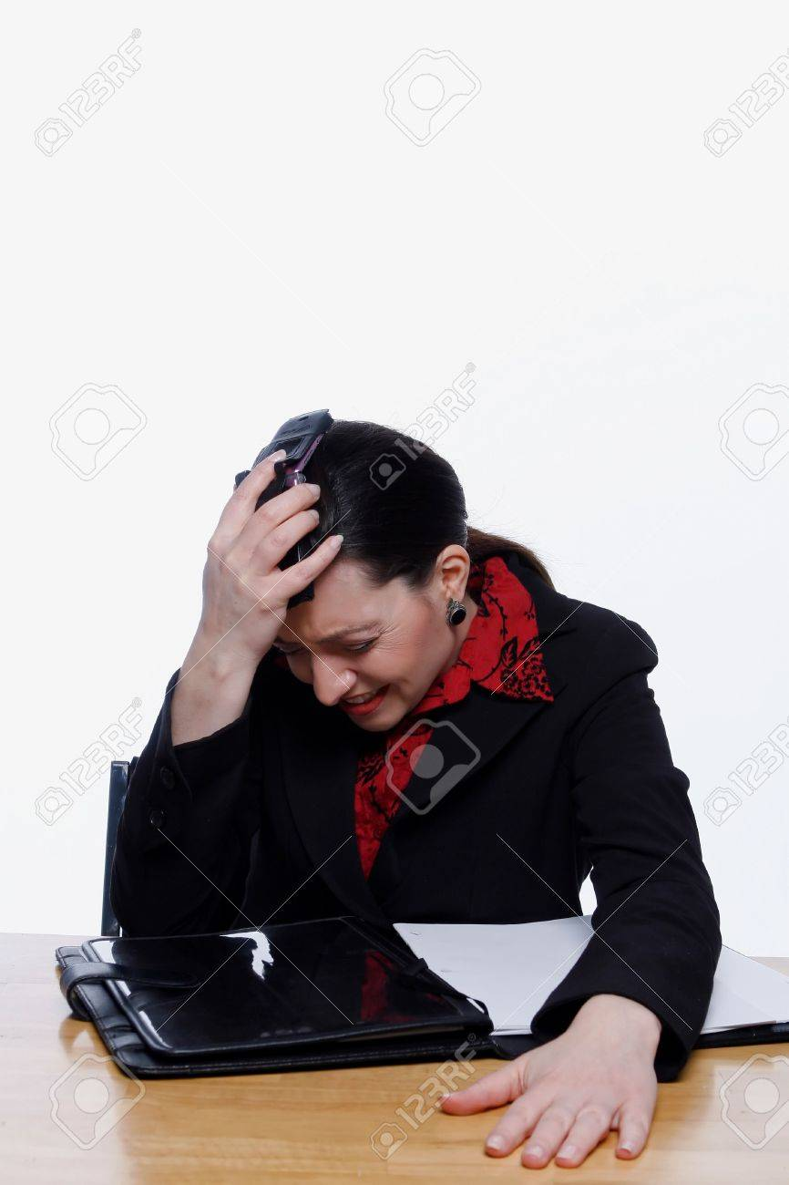 Businesswoman banging her phone against her head with a look of anguish on her face. Isolated against a white background. Stock Photo - 3002571
