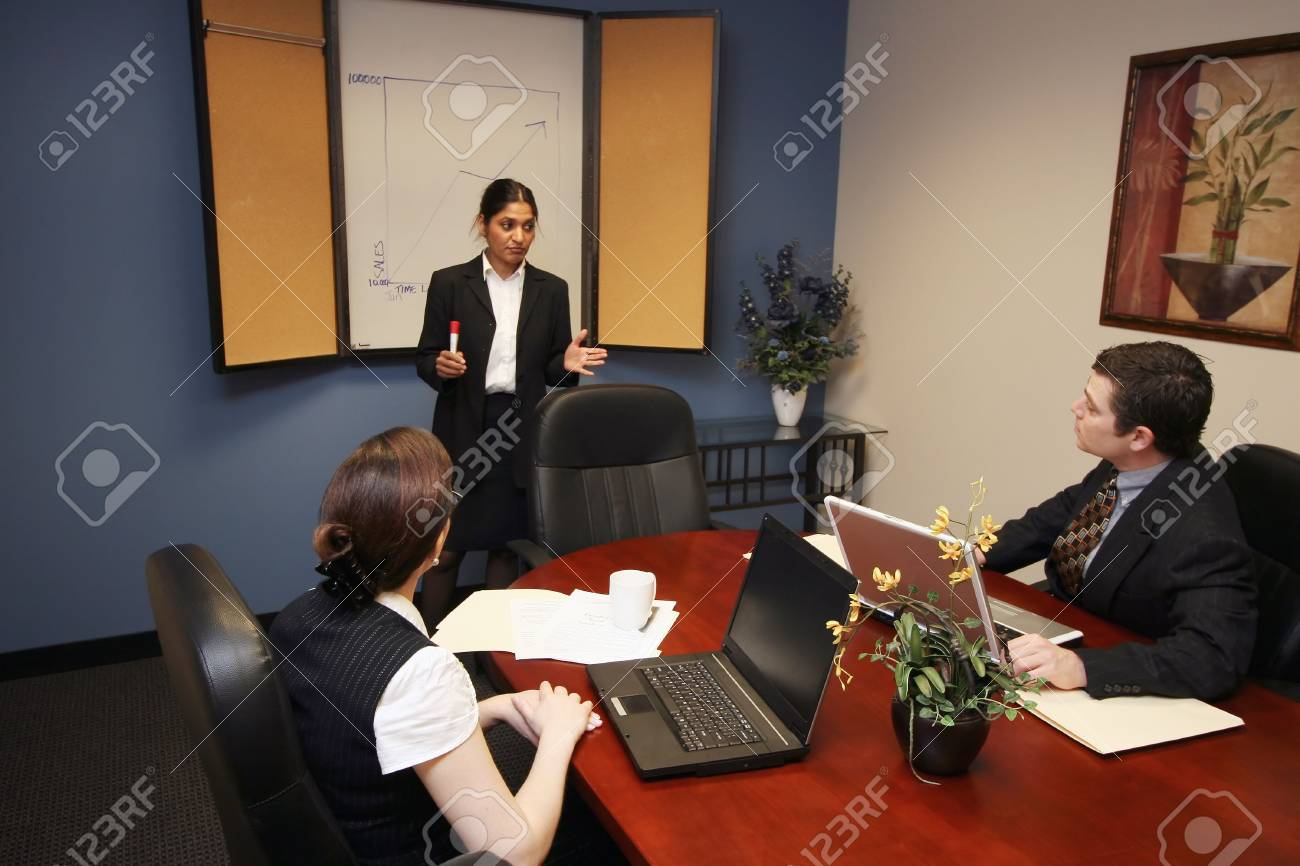 Indian businesswoman presenting to her colleagues during a meeting Stock Photo - 3020007