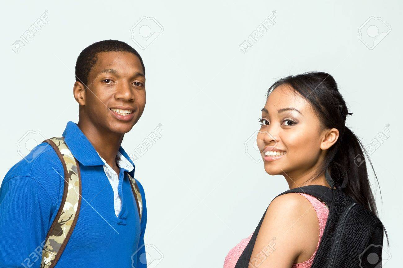 Two students wearing backpacks look at the camera and smile. Horizontally framed photograph Stock Photo - 3264028