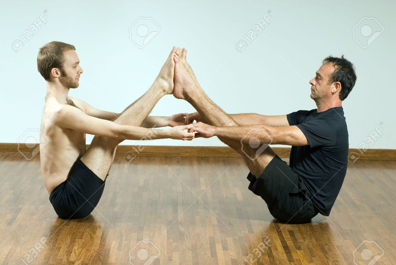 Two Men In A Yoga Pose Stock Photo Picture And Royalty Free Image