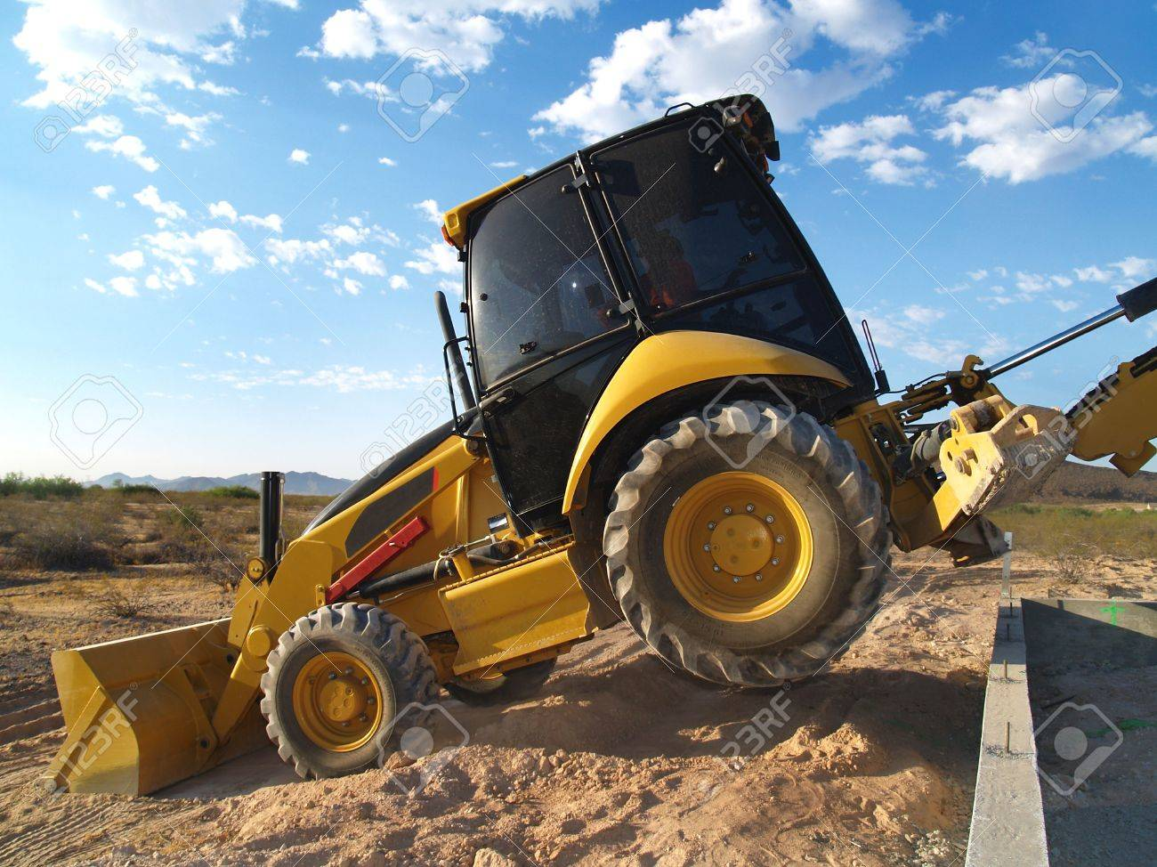 A large machine shovel is scooping dirt on an excavation site.  Horizontally framed shot. Stock Photo - 3338983
