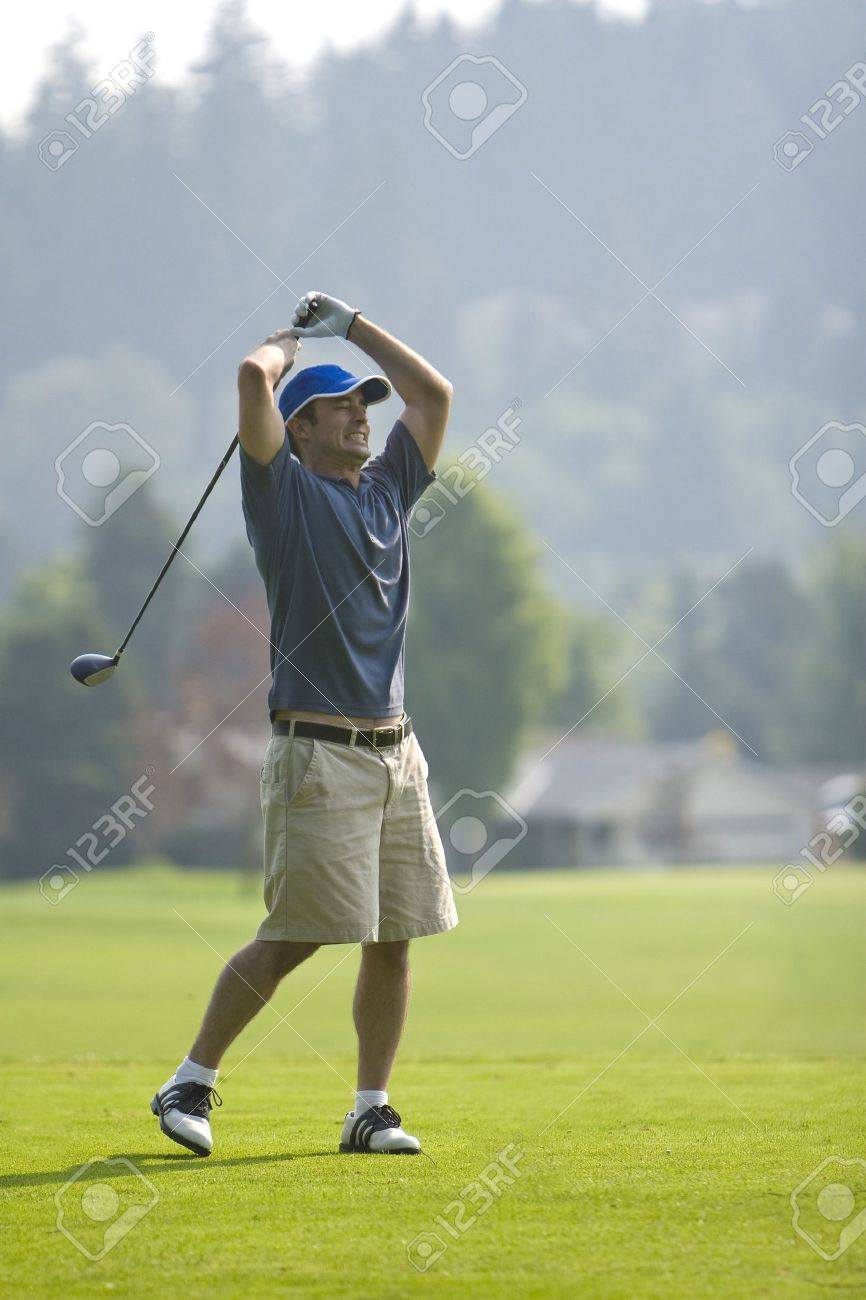 An Angry Golfer Stands About To Smash His Golf Club Into The