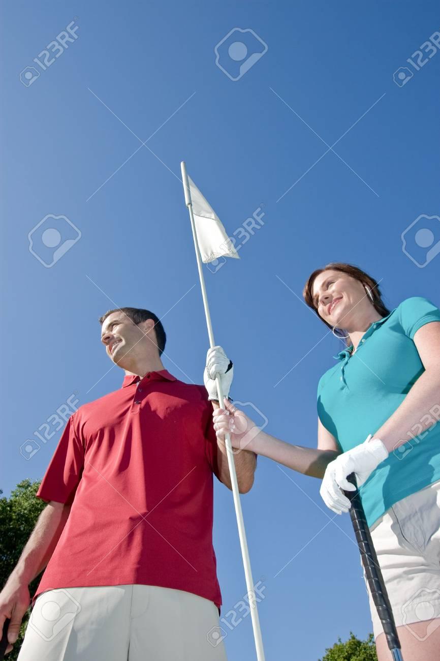 Männliche Und Weibliche Golfer Betrieb Golf-PIN Eingeben. Bild Von ...