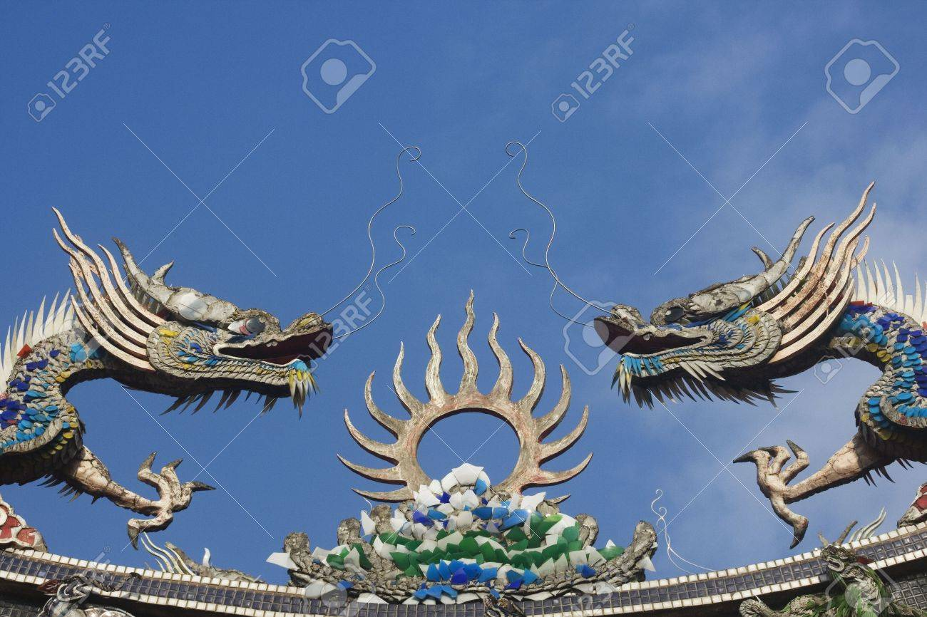 Chinese dragons on a temple roof.  Dragons have a special place in Chinese mythology.  Traditional they were thought to control to the weather and water related things. Stock Photo - 4015224