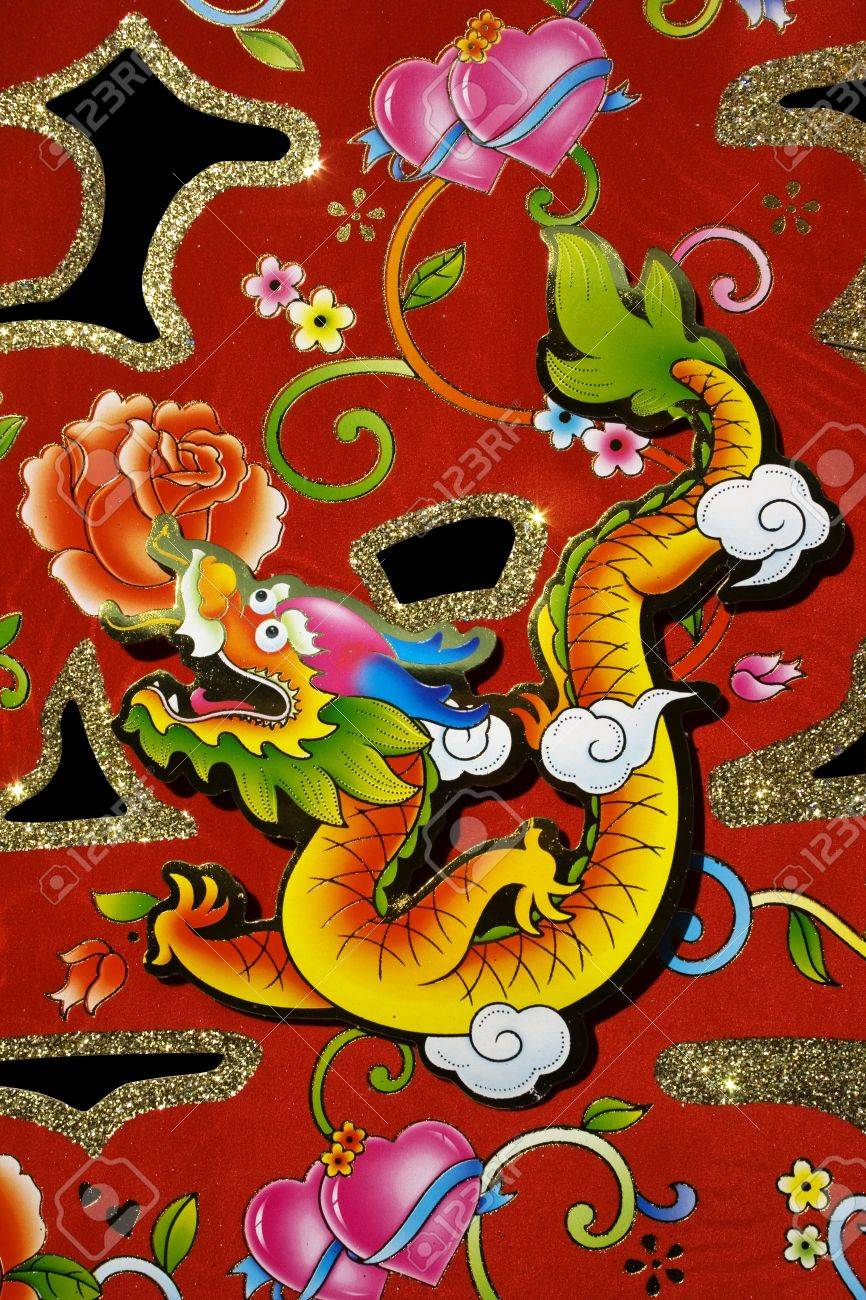 Chinese decoration for Chinese New Year.  This is a dragon motif on decoration used for Chinese New Year, also known as Spring Festival.  With black background. Stock Photo - 4112567