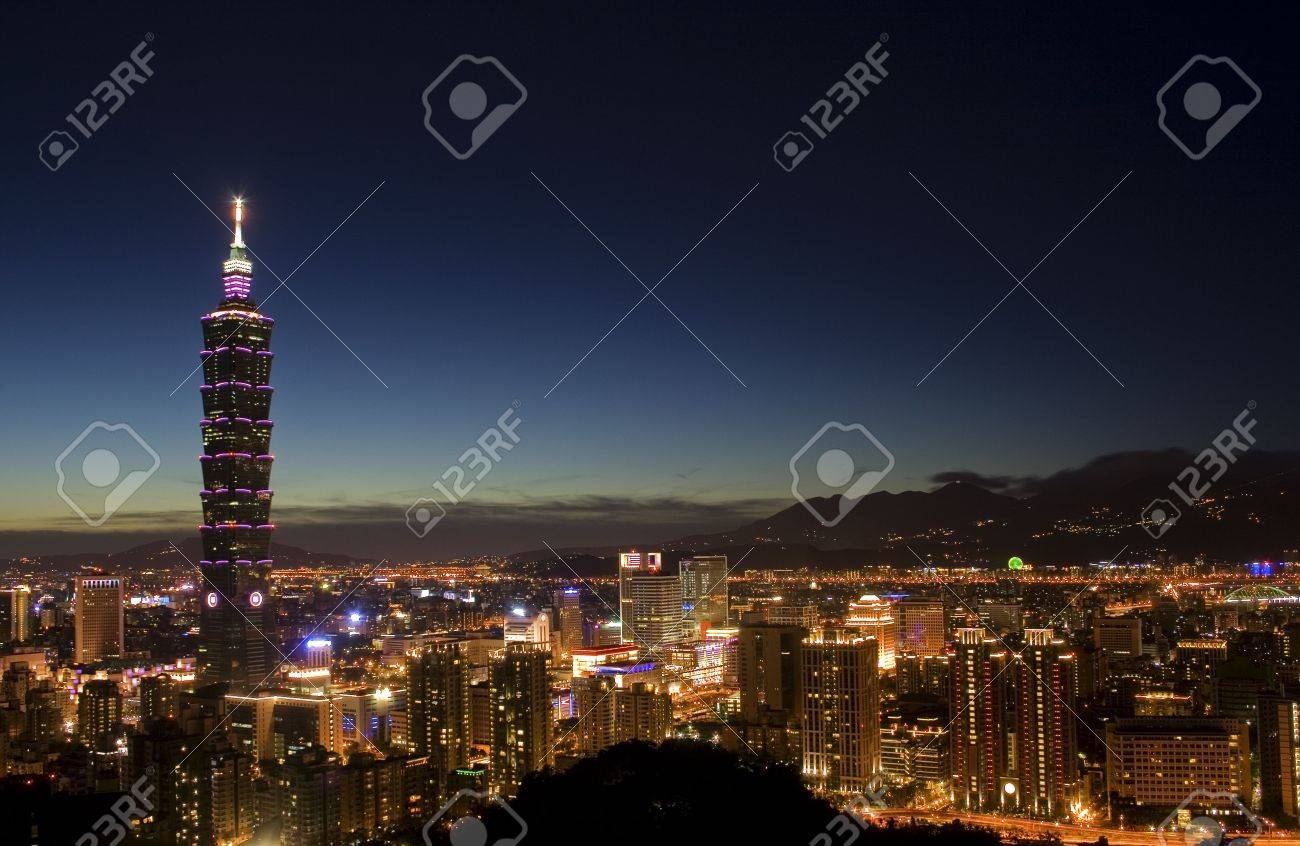 This is a view of Taipei City just after sunset.  The tall building is Taipei 101 and the closest area is Taipei commerical district. Stock Photo - 5237155