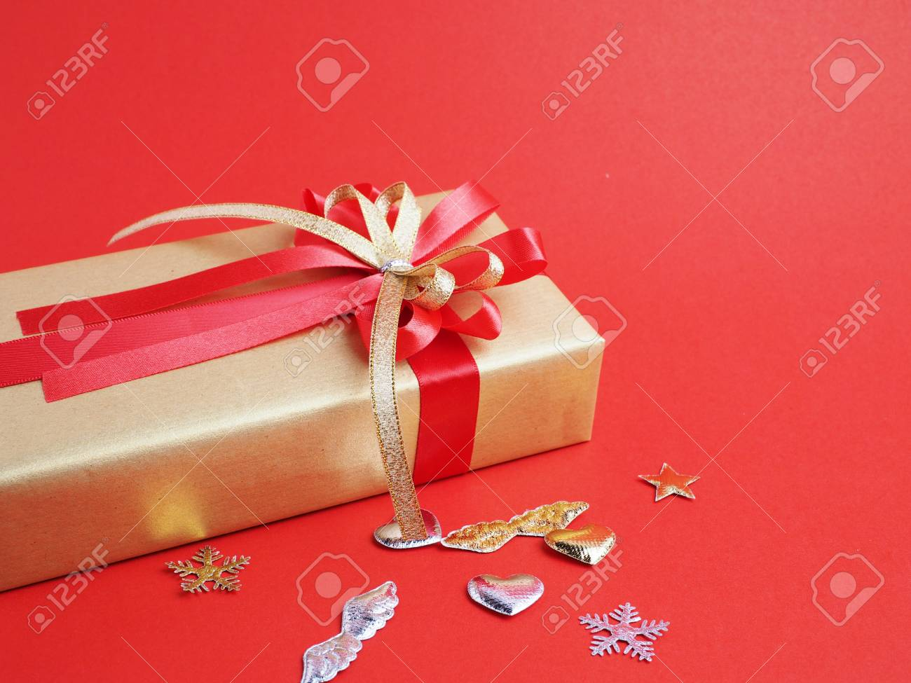 gift box decoration on red background christmas and new year concept stock photo