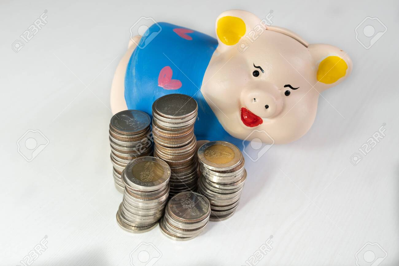 saving money with Blue piggy bank and coins pile. - 128316547