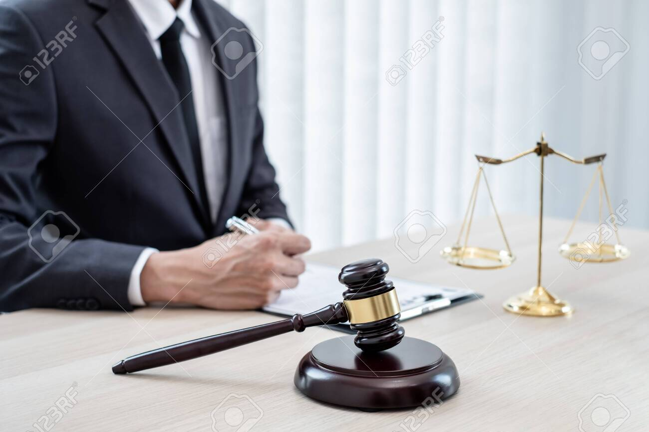 Judges gavel, Professional male lawyers work at a law office There are scales, Scales of justice, judges gavel, and litigation documents. Concepts of law and justice. - 153769375