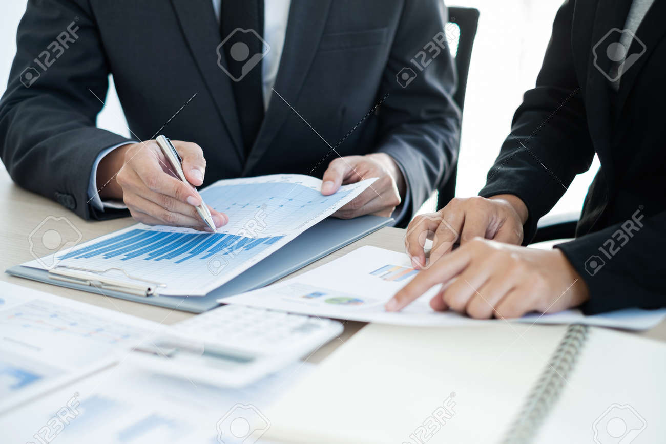 Two business leaders talk about charts, financial graphs showing results are analyzing and calculating planning strategies, business success building processes. - 158597011