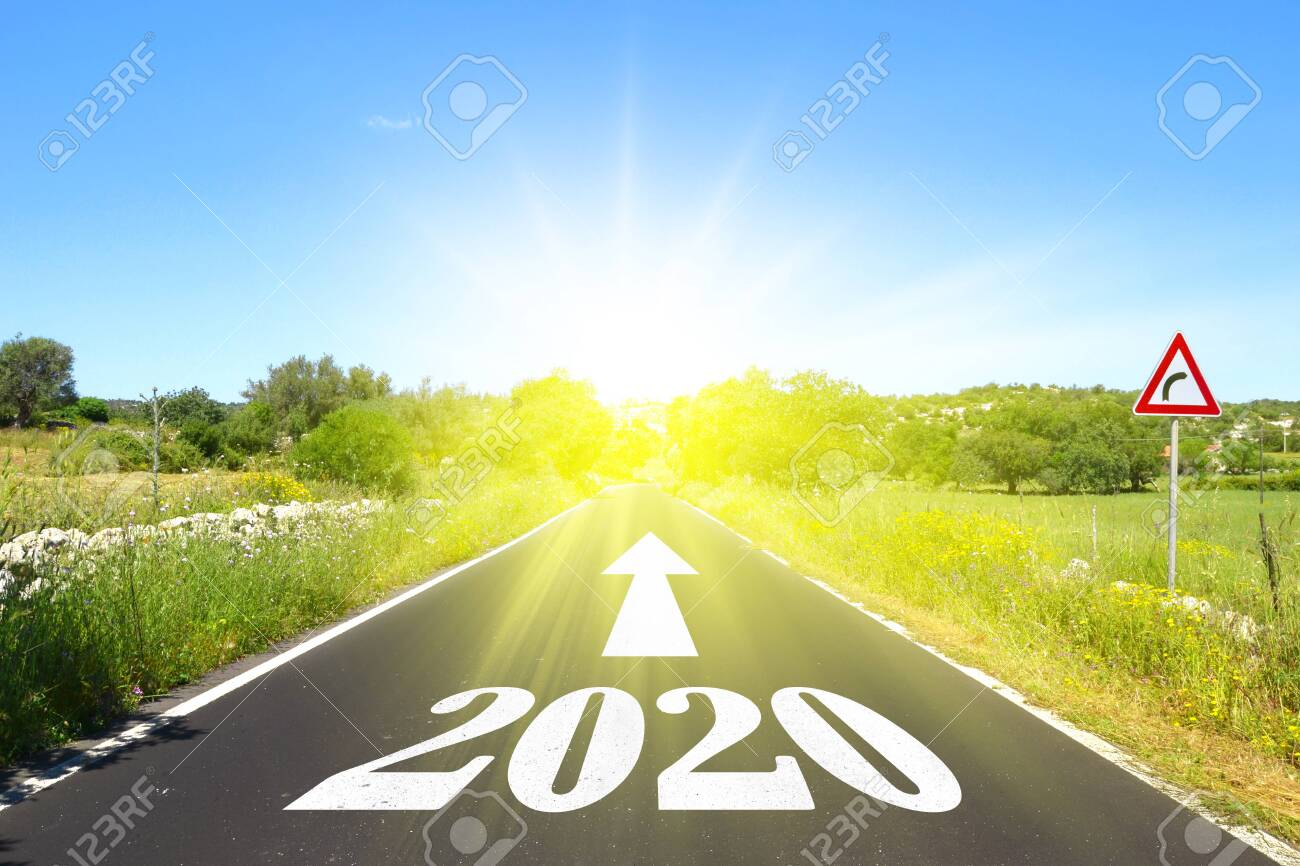 Highway with written 2020 with arrow and sun - 135735340