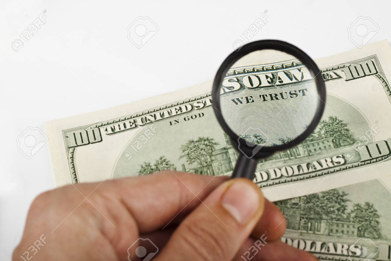 magnifying a dollar bill with a magnifying glass on white background Stock Photo - 9309483