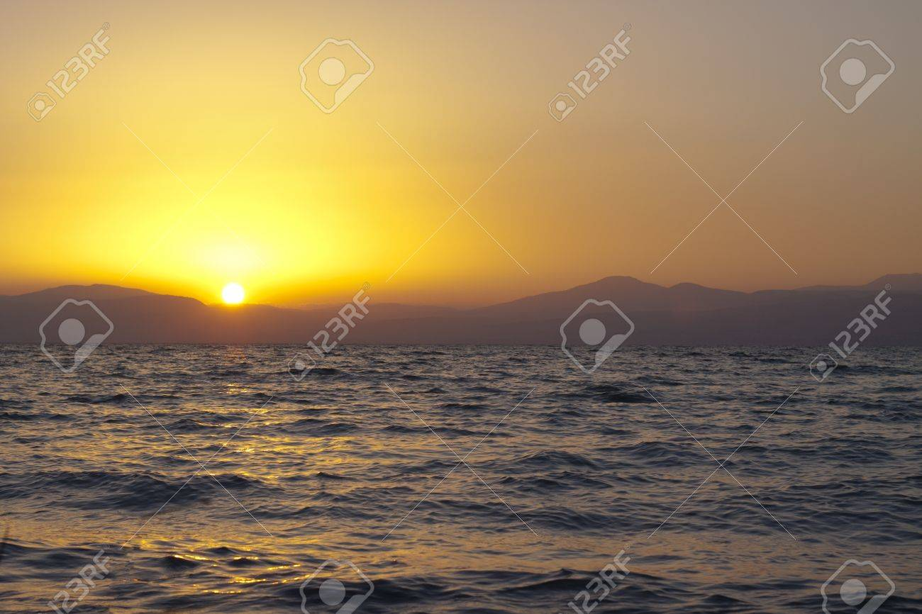 sunset over mountain peek with the sun reflection in the watter Stock Photo - 9313513