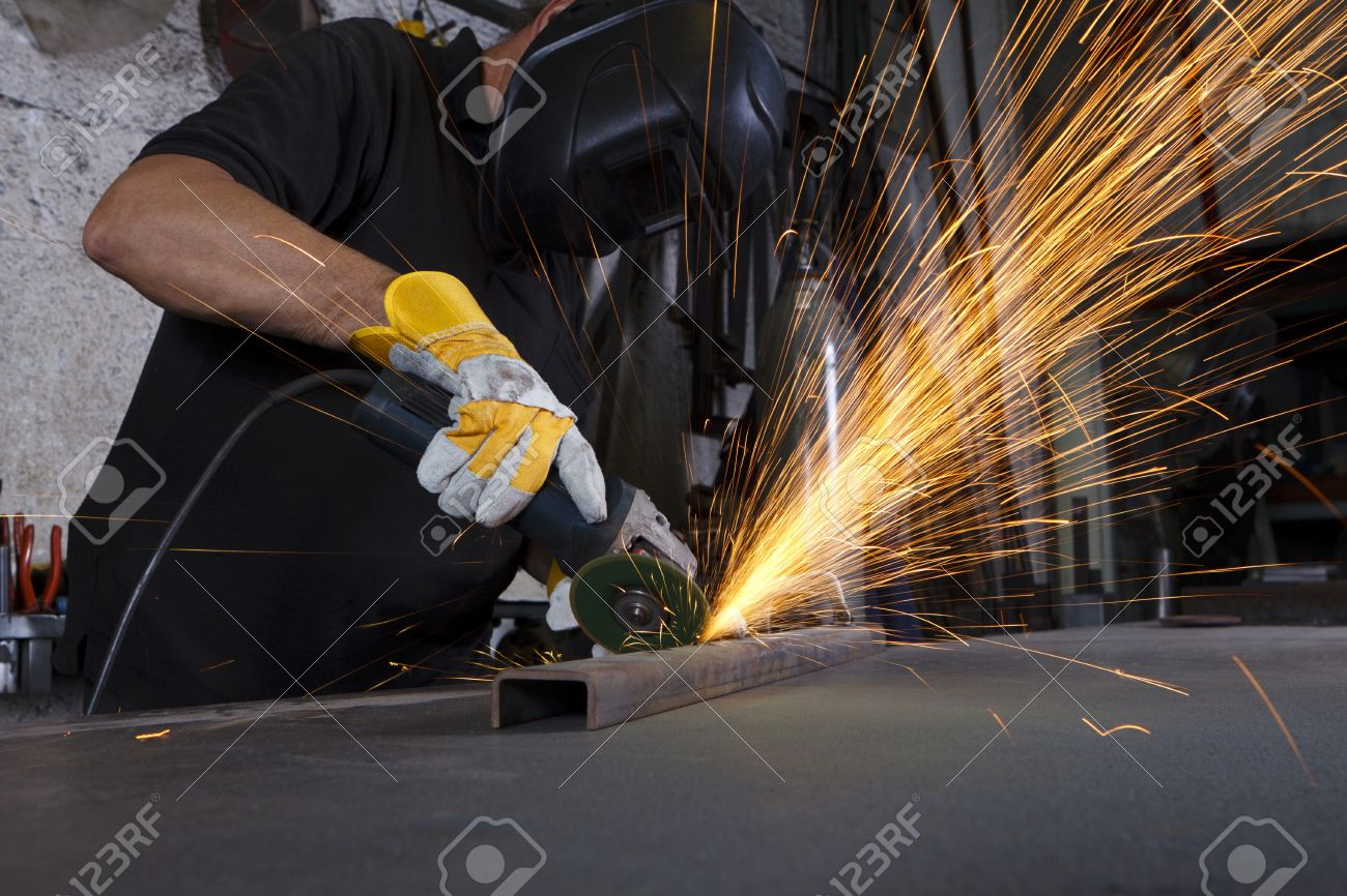 sparks flying over the working table during metal grinding Stock Photo - 9735697