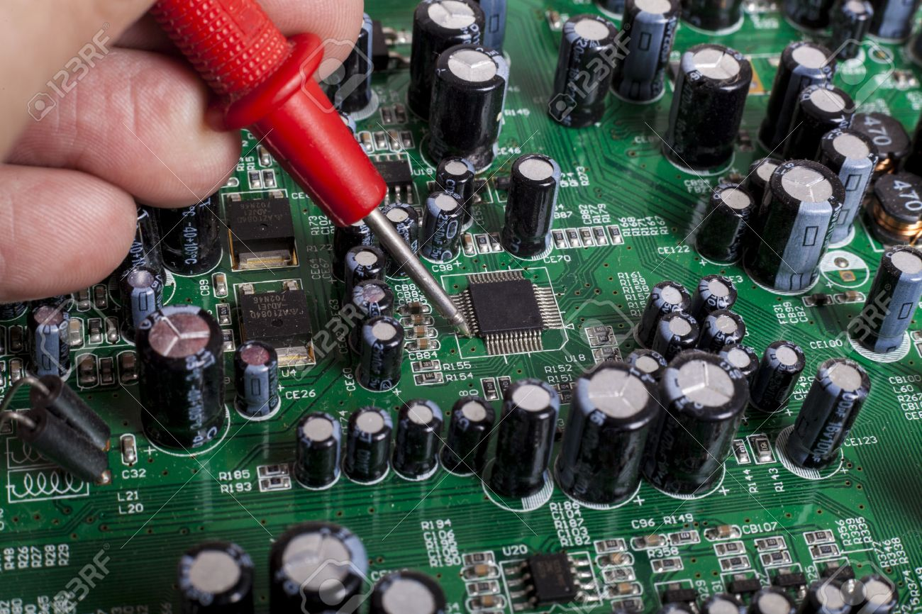 Circuit Board Repair Services In Ri Online User Manual Printed Repairs Electronics Service Close Up With Red Probe And Capacitors Rh 123rf Com Tree