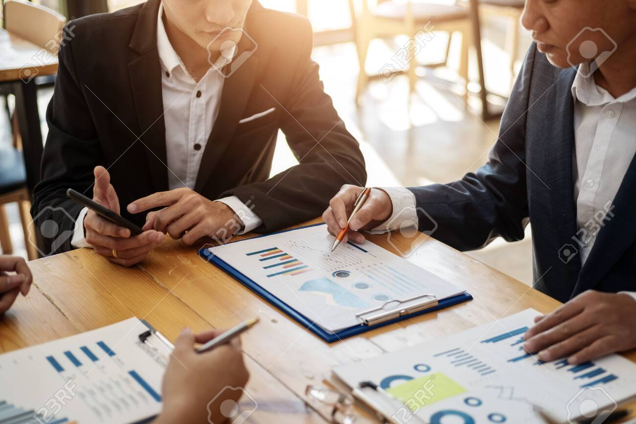 Business team professionals working analyzing data with financial report in the office. Accounting concept. - 120506995