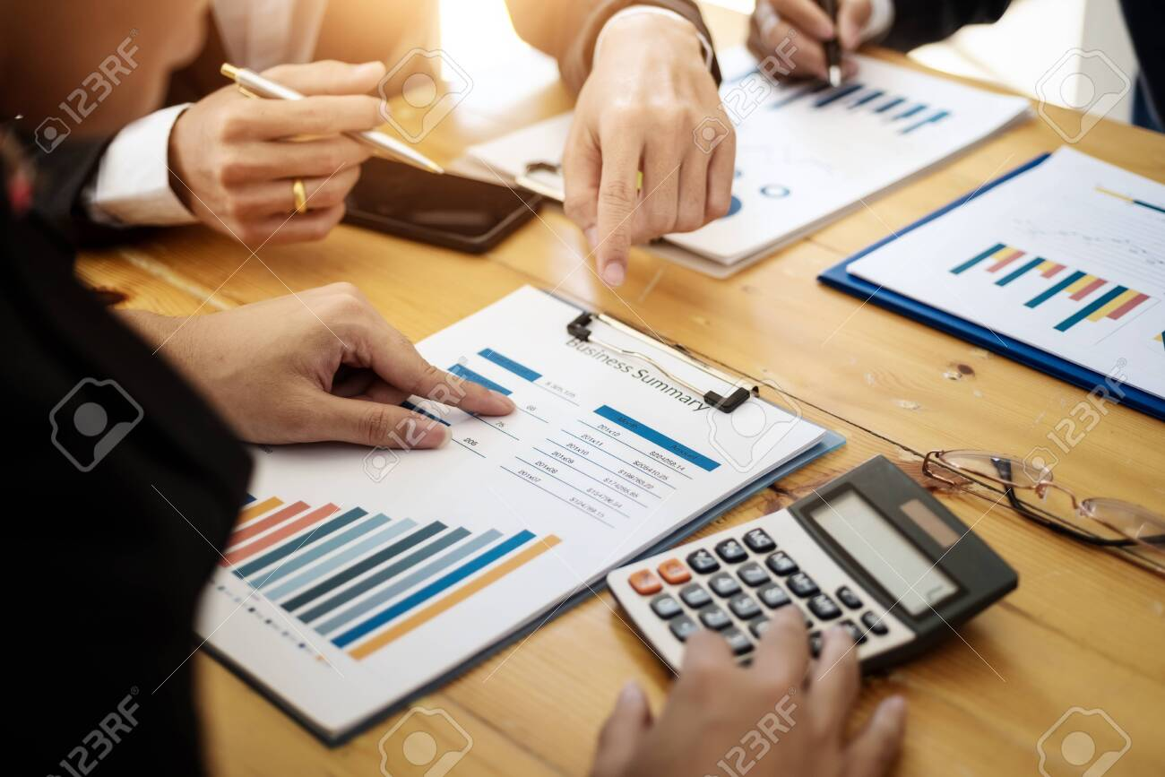 Business team professionals working analyzing data with financial report in the office. Accounting concept. - 120507027