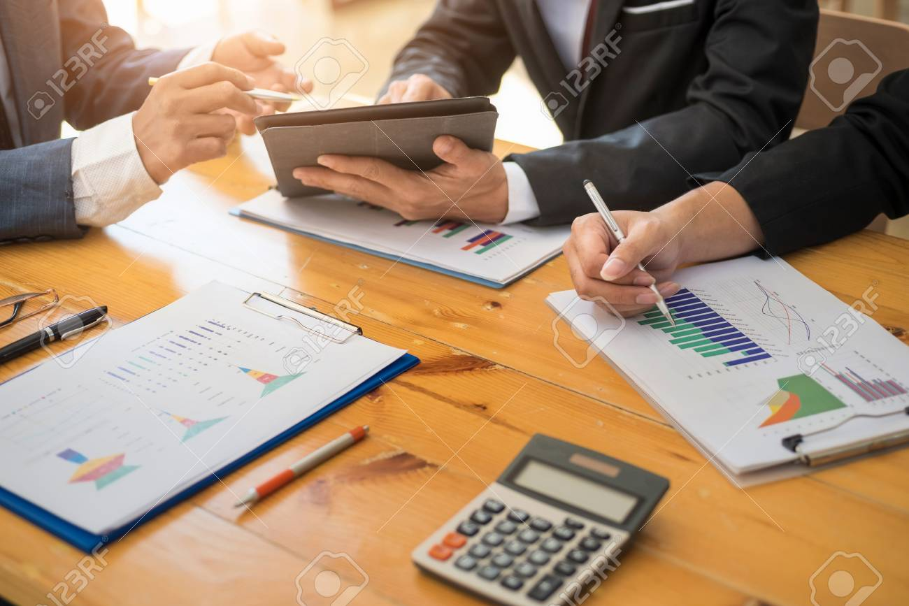 Group of business people working with laptop and tablat and paper graph in the office room. Accounting concept. - 120507110