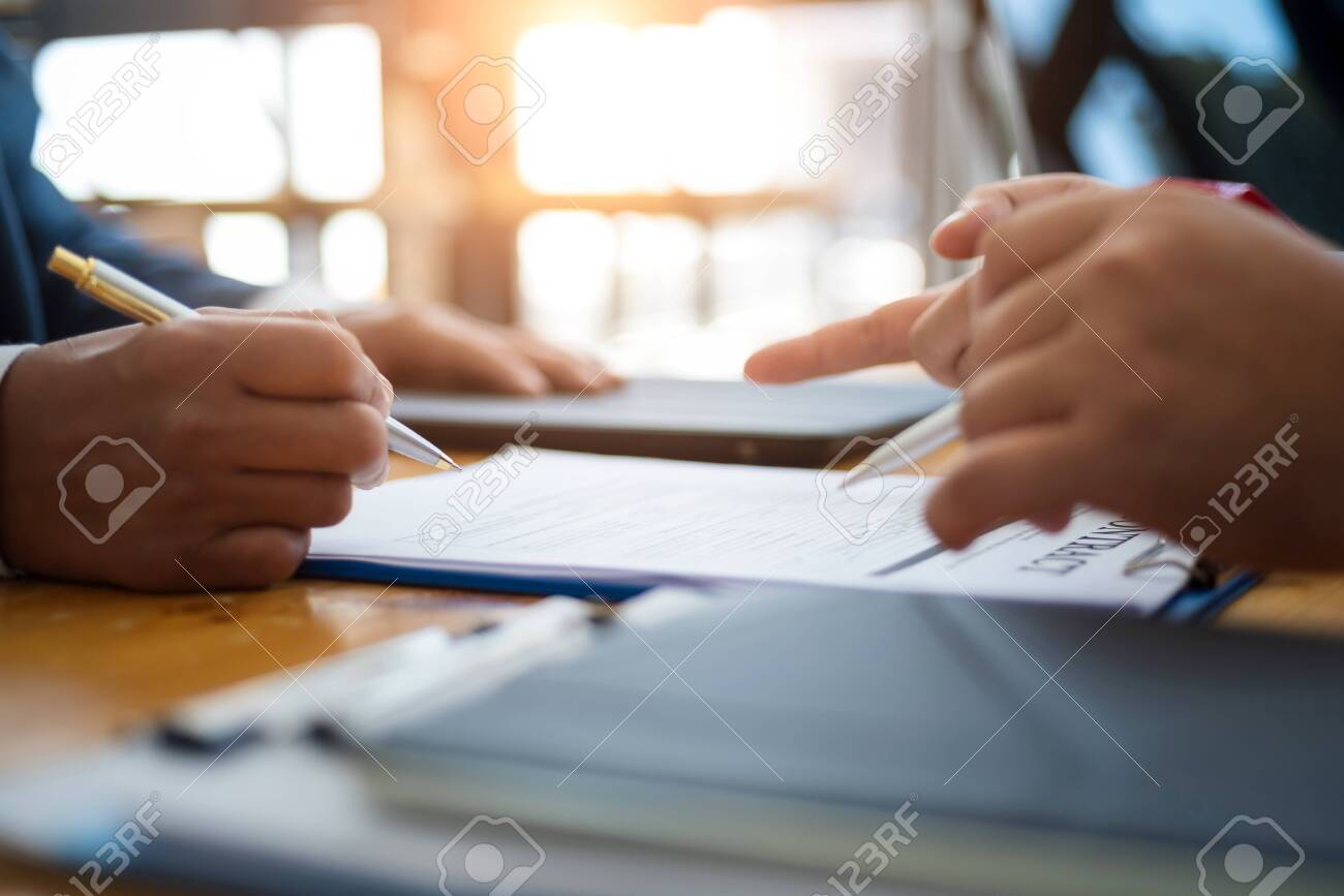 Business people discussion and negotiating investment housing estate with sign a contract term loan facility in office. contract and agreement concept. - 120507454