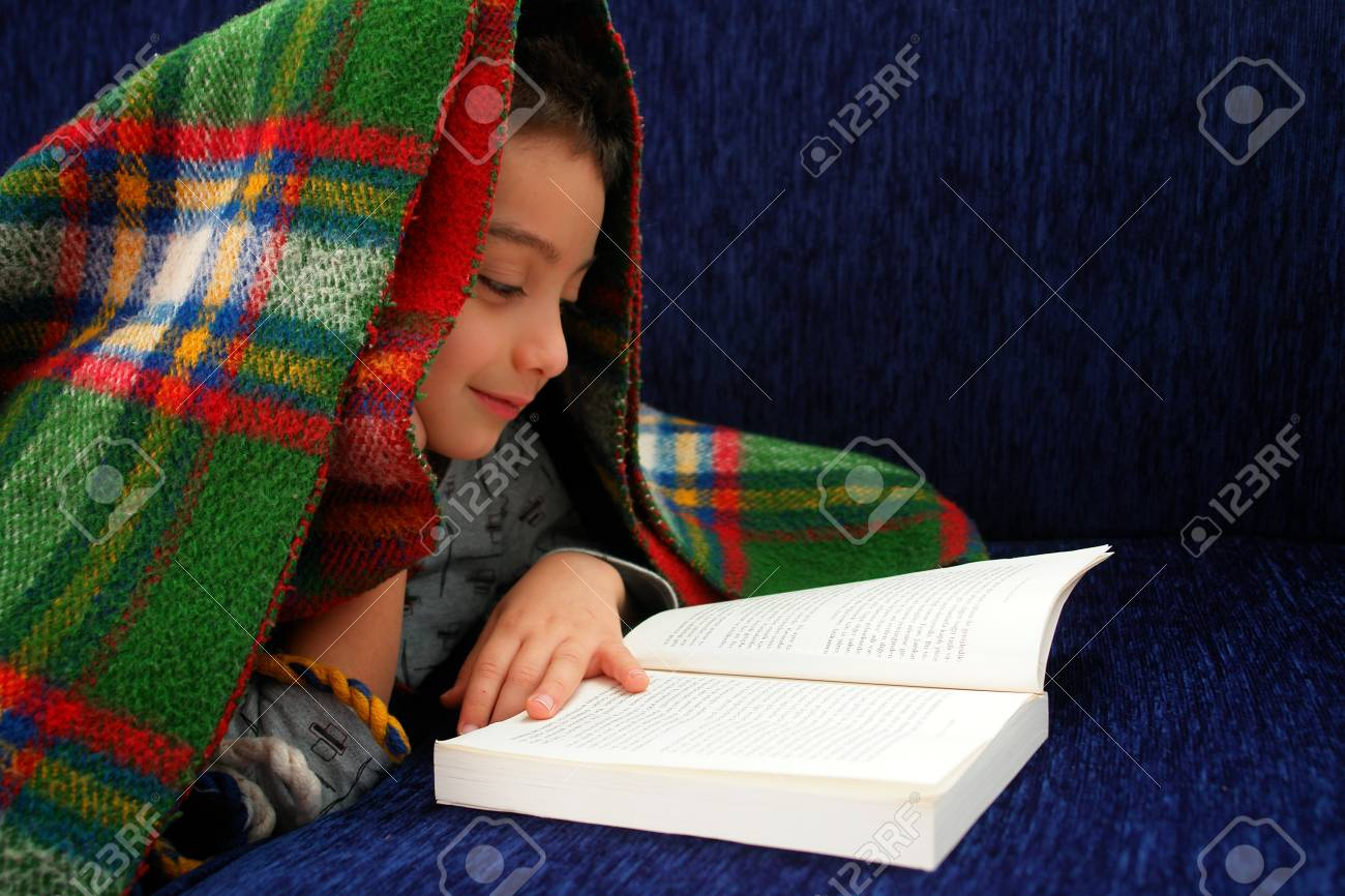 Boy reads book under blanket Stock Photo - 9726793