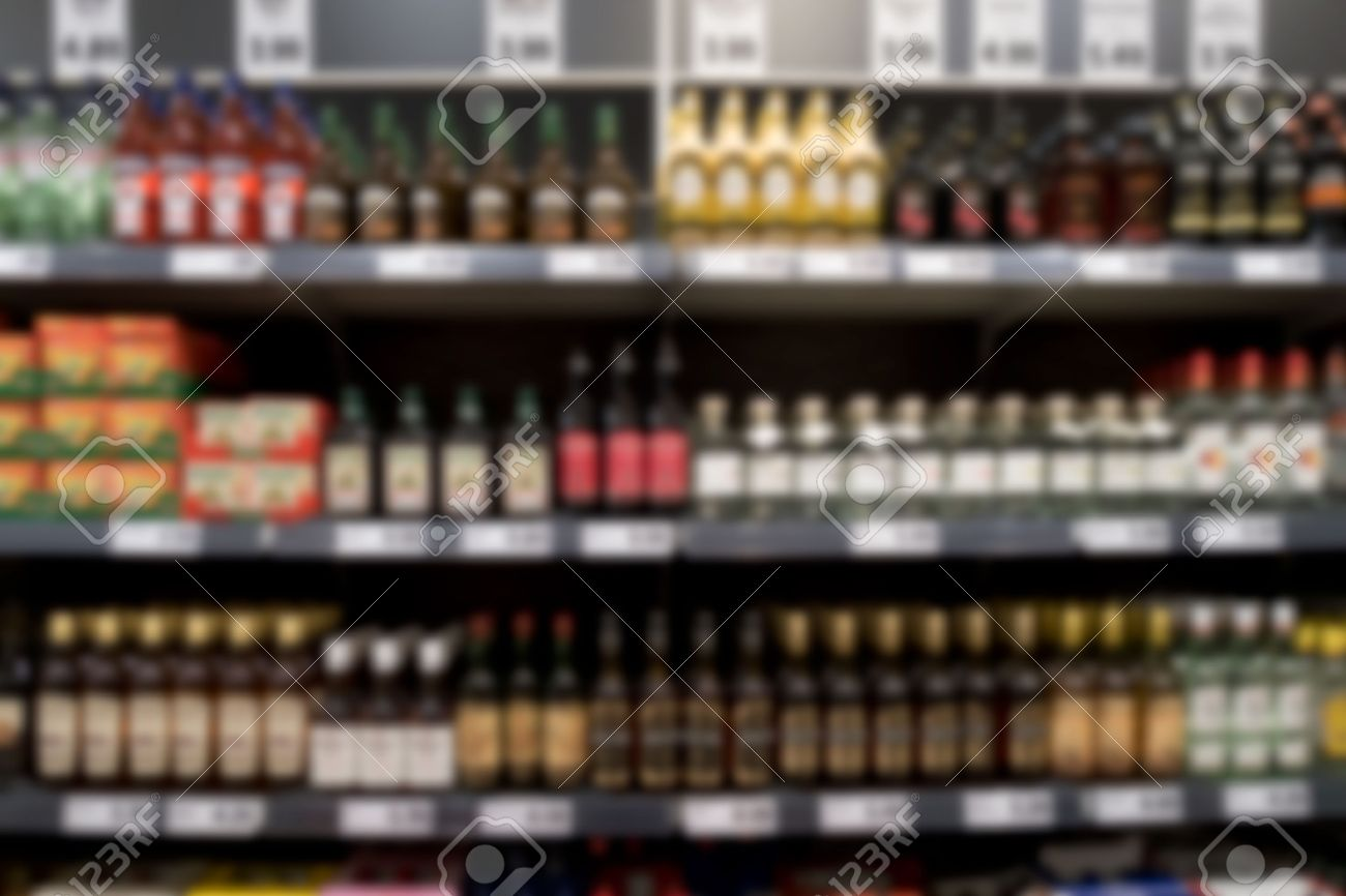 Out Of Focus Supermarket Shelf With Spirits And Wine Unrecognizable