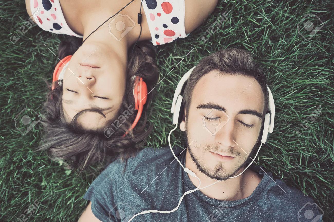 Couple listening to music on headphones Stock Photo - 34238385