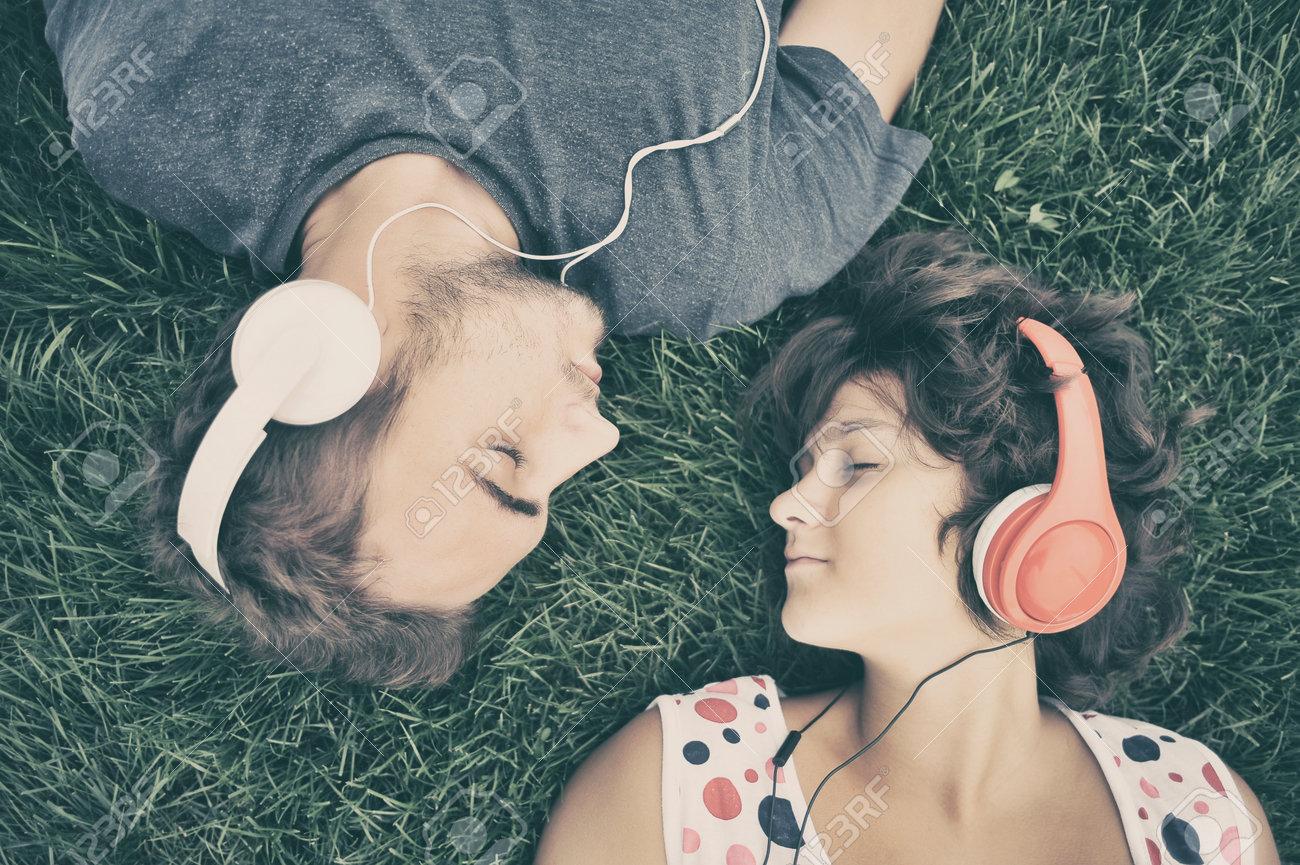Couple listening to music on headphones Stock Photo - 34238160