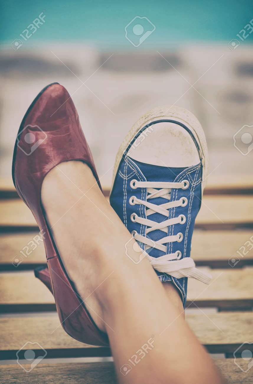 Woman legs in different shoes Stock Photo - 34238455