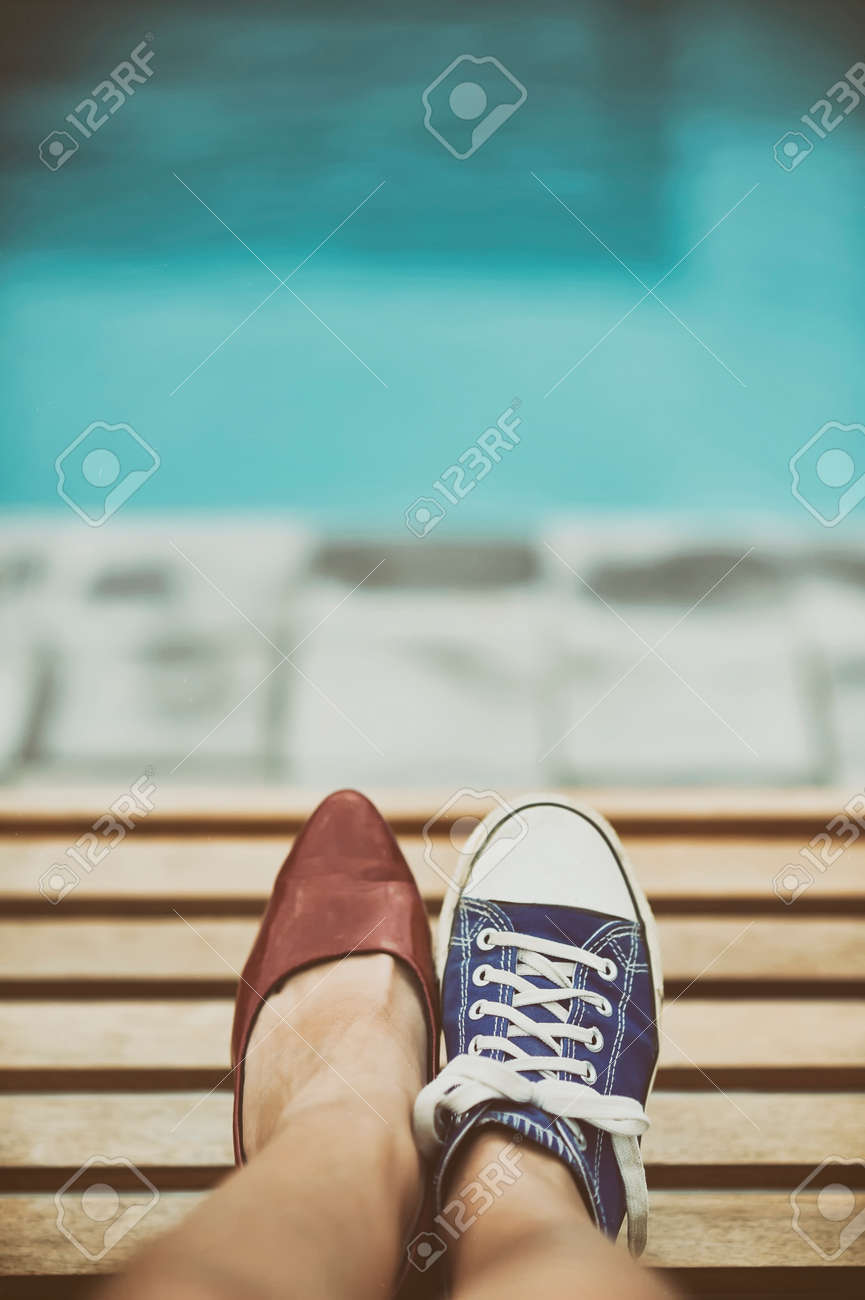 Woman legs in different shoes Stock Photo - 34238461