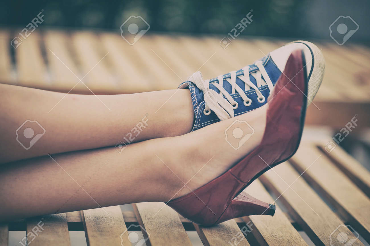 Woman legs in different shoes Stock Photo - 34238479