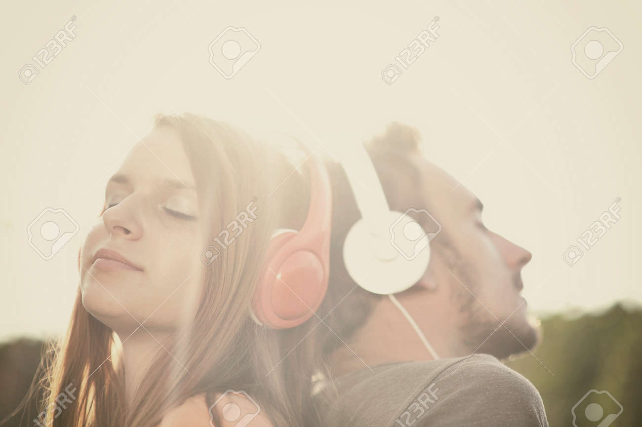 Boy and girll listening to music on headphones Stock Photo - 34239538