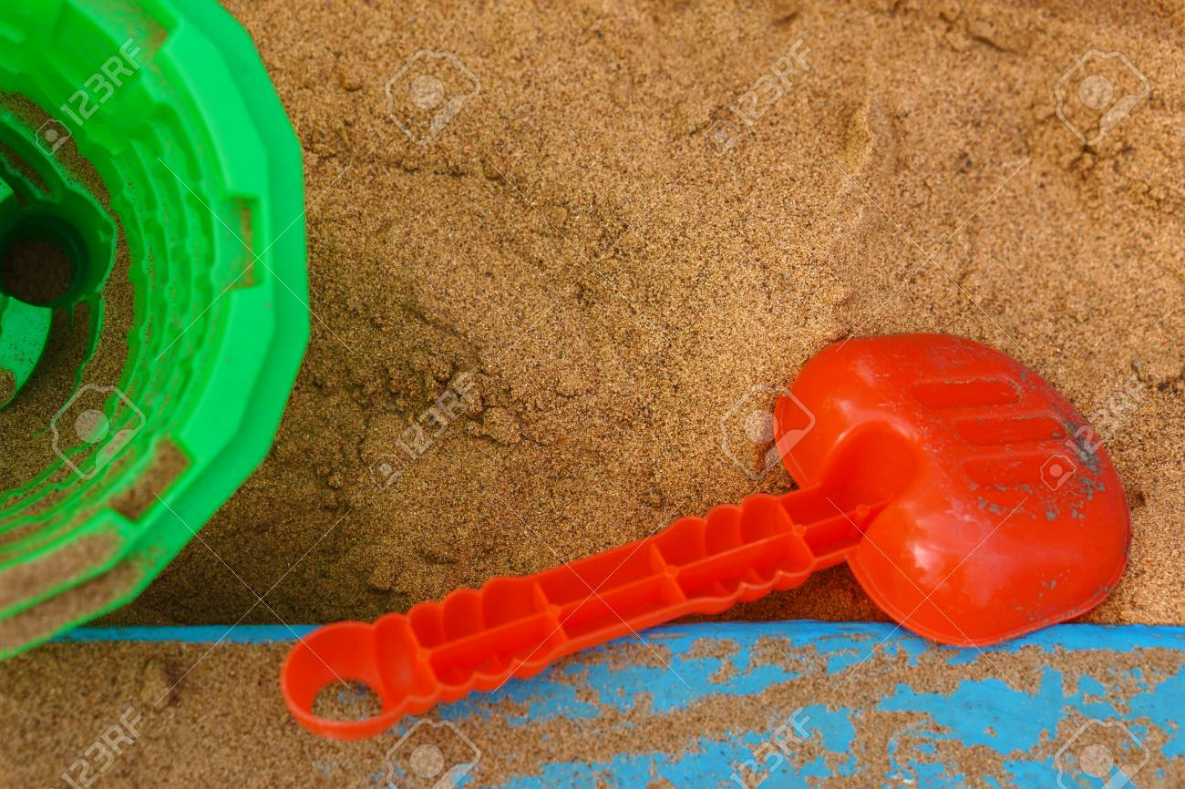 A Template Consisting Of Sand In A Sandbox, A Children\'s Shovel ...