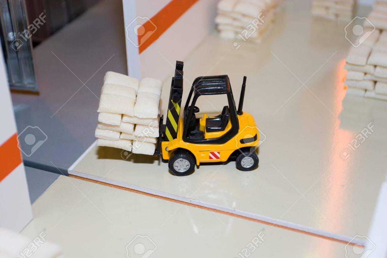 The forklift truck loader cargo in a toy warehouse stock photo 7600803