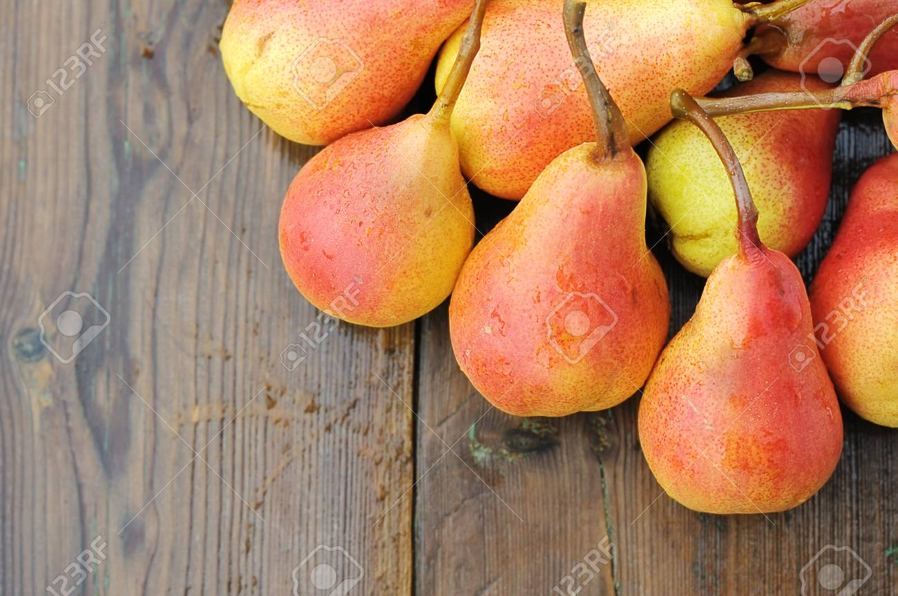 Ripe pears on a wooden table. Stock Photo - 12566693