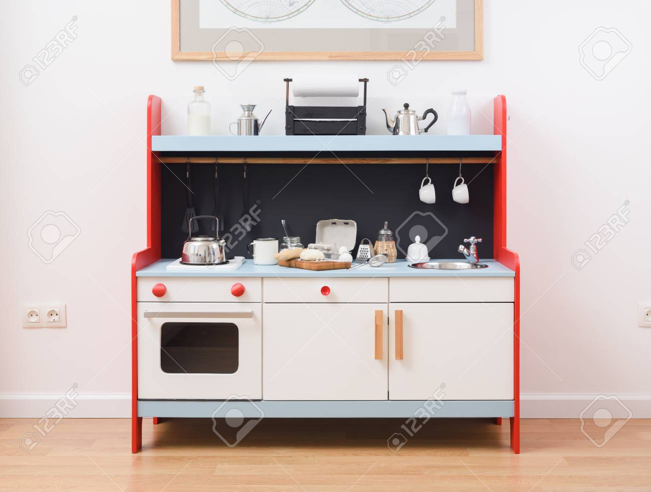 Play kitchen and toy kitchenware for children. Making dough for..