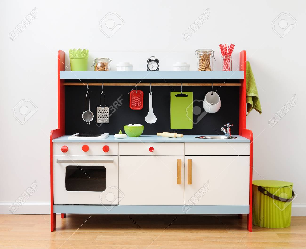 Colorful toy kitchen with kitchen utensils ready for children..