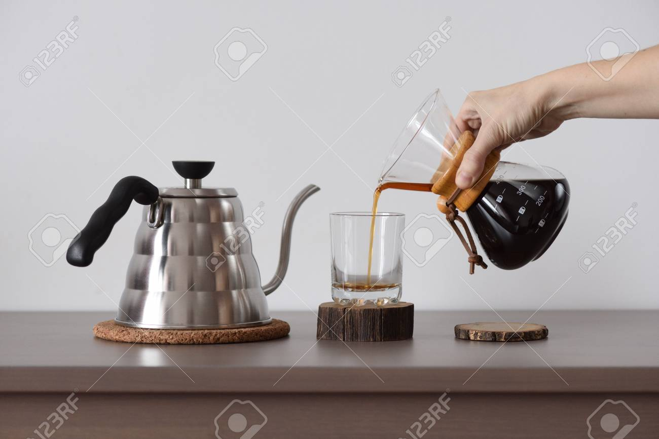 Brewing Coffee In Hand Drip Coffee Maker Woman Hand Pour Coffee