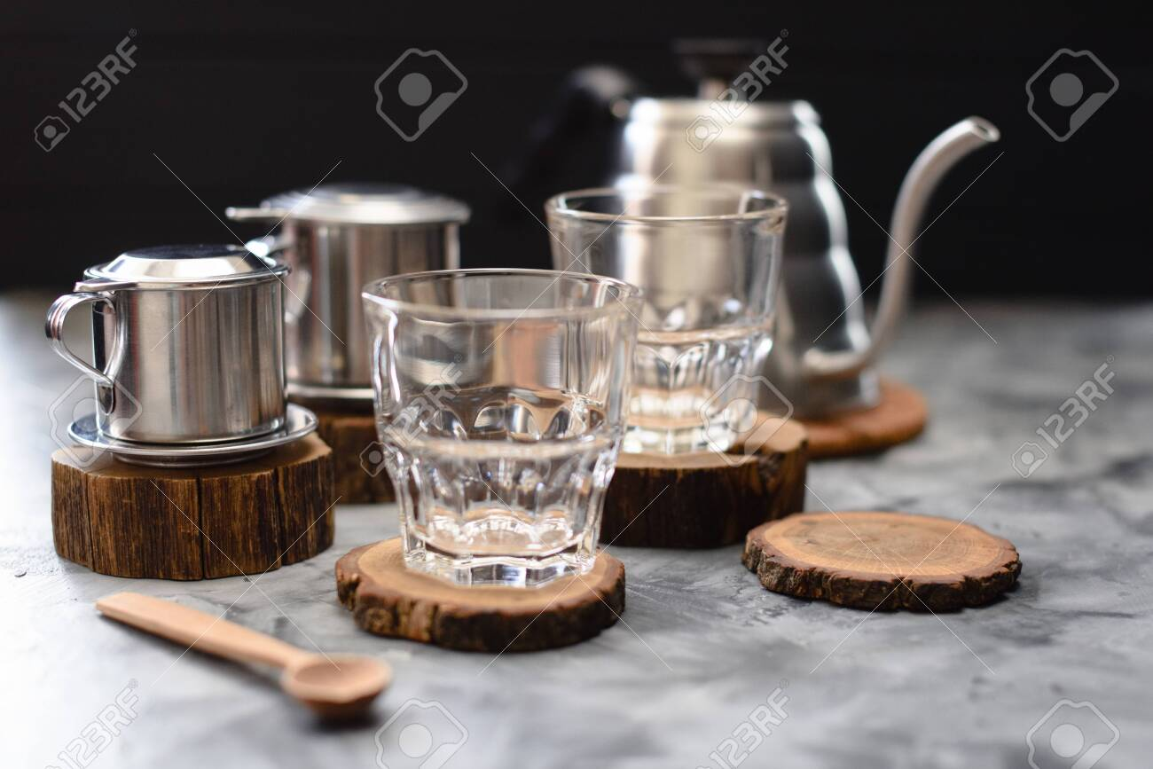 Glasses Phin Coffee Makers And Goose Neck Kettle On Wood Slabs Stock Photo Picture And Royalty Free Image Image 128799163