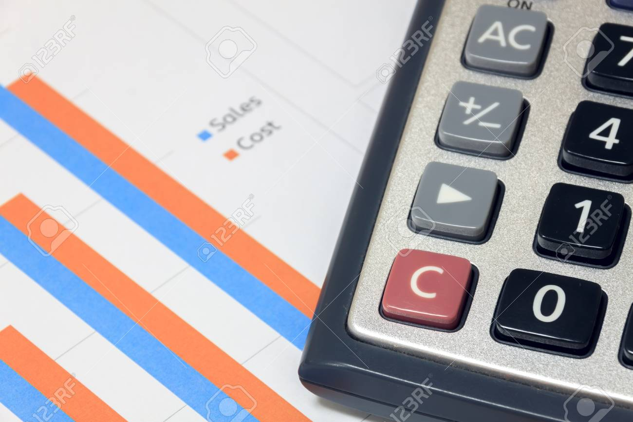 selective focus calculator on sales cost chart document stock photo